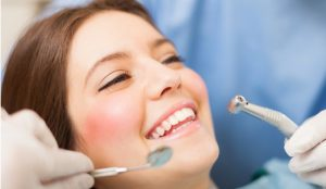 Woman in dental chair smiling image